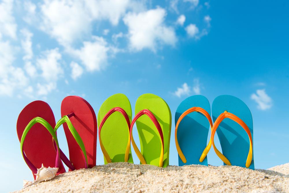 Bild von Flip Flops im Sand